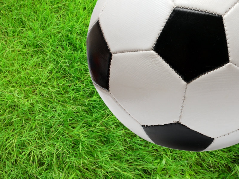 204282-football-soccer-ball-over-green-grass